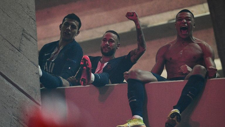 Neymar and Kylian Mbappe celebrate on a balcony with the fans outside the ground