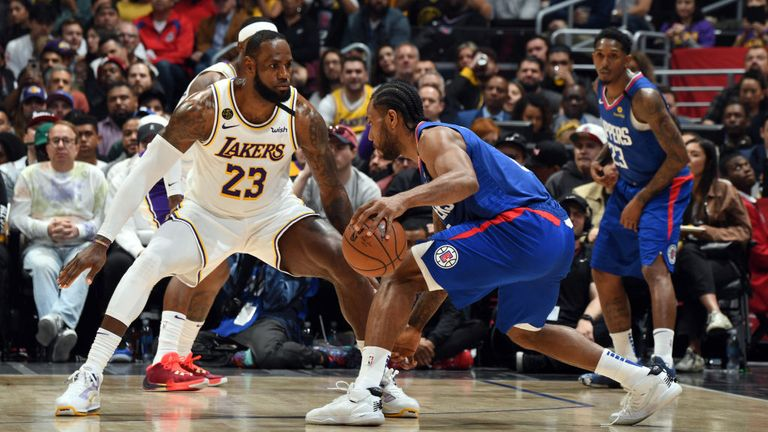 LeBron James of the Los Angeles Lakers plays defense against Kawhi Leonard of the LA Clippers