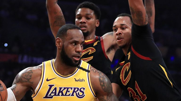 LeBron James is surrounded by Cavaliers defenders