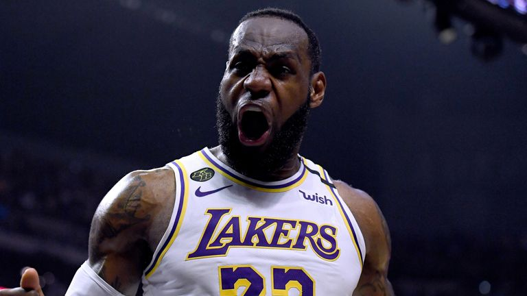 LeBron James roars in celebration during the Lakers' victory over the Clippers