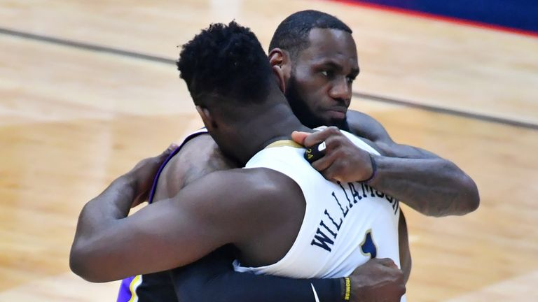 Zion Williamson and Lebron James embrace during the New Orleans Pelicans and LA Lakers game