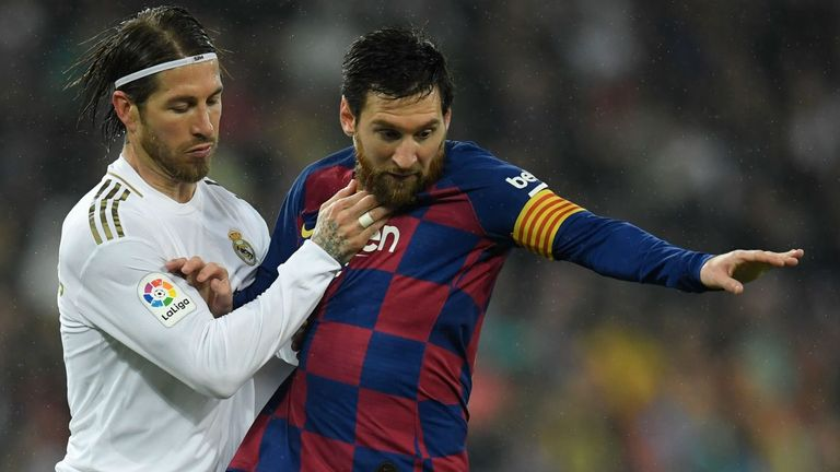 Lionel Messi and Sergio Ramos battle for possession