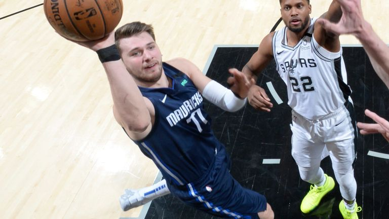 Luka Doncic lofts a floater against the Spurs