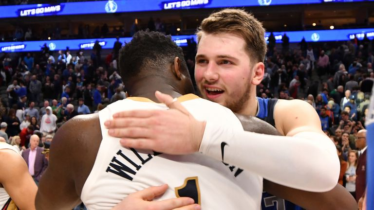 Luka Doncic (R) of the Dallas Mavericks hugs rookie Zion Williamson of the New Orleans Pelicans after their first clash on Wednesday.