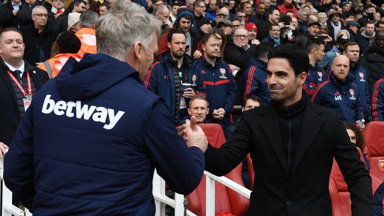 David Moyes (L) greets Mikel Arteta (R) prior West Ham's defeat to Arsenal