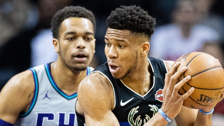 Giannis Antetokounmpo posts up against the Hornets