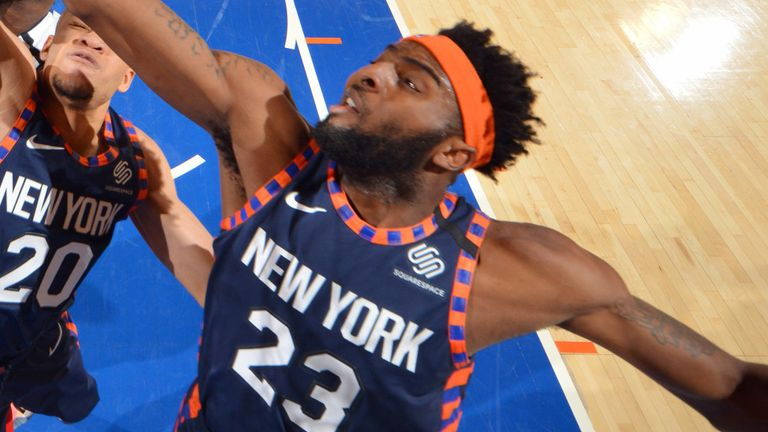 Mitchell Robinson leaps for a rebound against Detroit