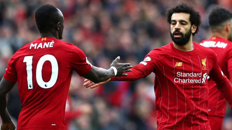 Mohamed Salah celebrates with Sadio Mane after scoring against Bournemouth