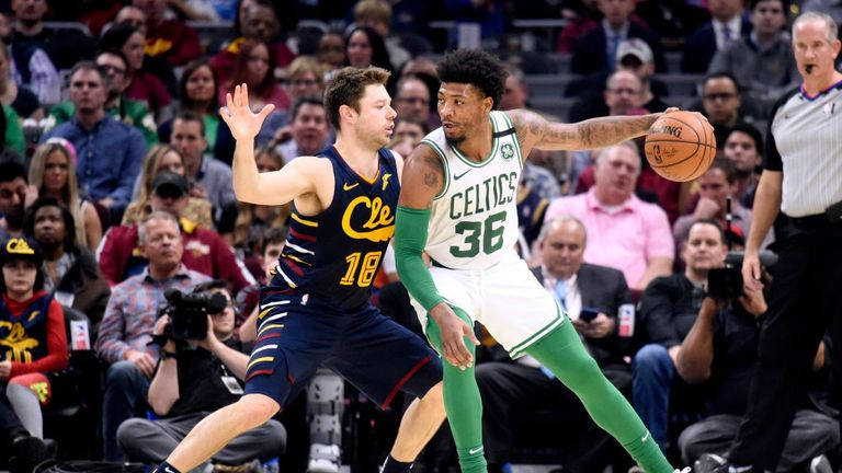Marcus Smart #36 of the Boston Celtics posts up against Matthew Dellavedova #18 of the Cleveland Cavaliers during the first half at Rocket Mortgage Fieldhouse on March 04, 2020 in Cleveland, Ohio