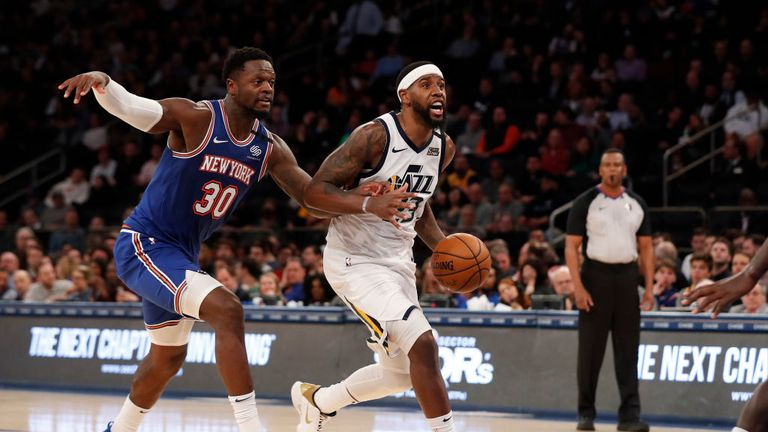 Royce O'Neale #23 of the Utah Jazz drives to the basket against Julius Randle #30 of the New York Knicks during the second half at Madison Square Garden on March 04, 2020 in New York City.