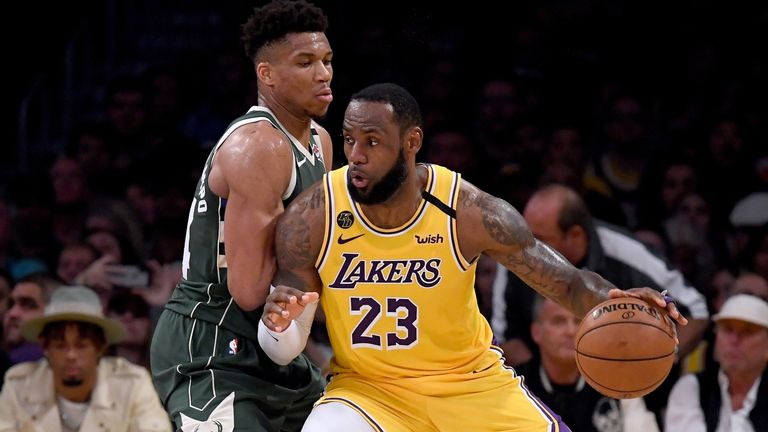 LeBron James backs into Giannis Antetokounmpo as the two superstars go head-to-head at Staples Center