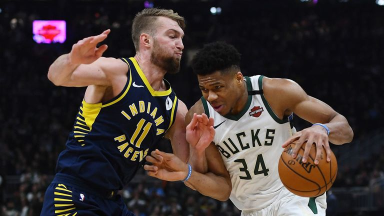 Giannis Antetokounmpo #34 of the Milwaukee Bucks is defended by Domantas Sabonis #11 of the Indiana Pacers during the first half of a game at Fiserv Forum on March 04, 2020 in Milwaukee, Wisconsin.