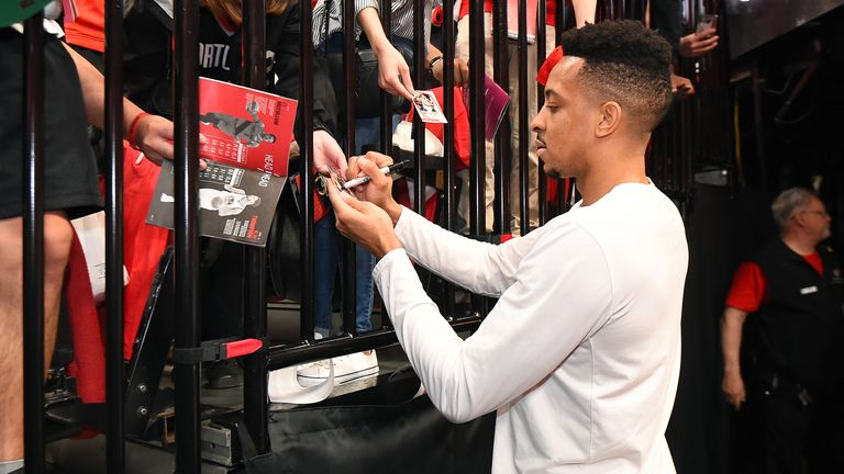 CJ McCollum of the Portland Trail Blazers has tweeted or retweeted several virus-related posts in the last couple days, and said he would stop signing autographs for the moment.