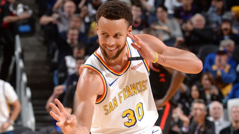Stephen Curry reacts after scoring during his return clash against the Raptors