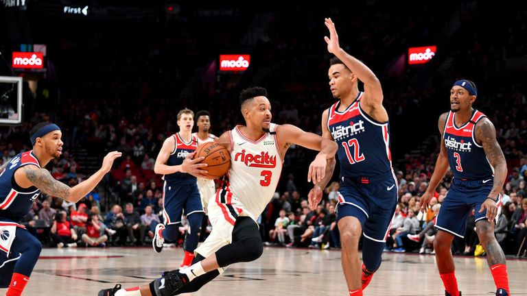 CJ McCollum #3 of the Portland Trail Blazers drives to the basket against Jerome Robinson #12 of the Washington Wizards during the first half of the game at the Moda Center on March 04, 2020 in Portland, Oregon.