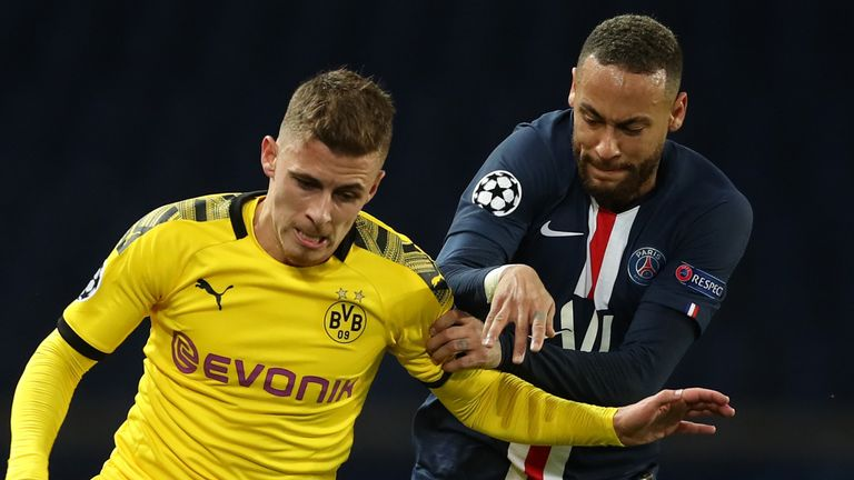 Neymar tracks back in a bid to regain possession for his side