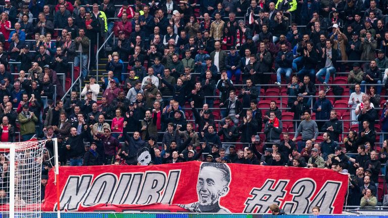 Ajax fans hold a banner up in support of Nouri