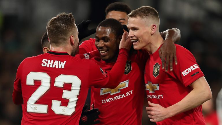 Odion Ighalo celebrates with Manchester United team-mates after scoring against Derby