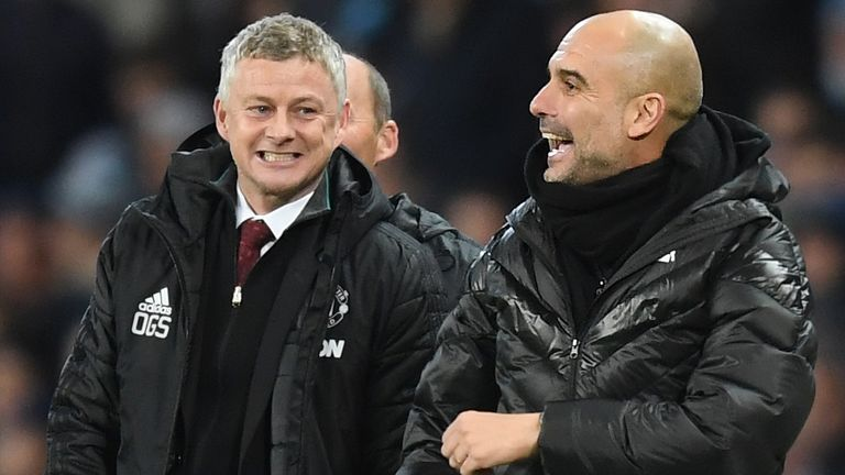 Ole Gunnar Solskjaer speaks to Pep Guardiola during the Premier League match between Man City and Man United at the Etihad Stadium