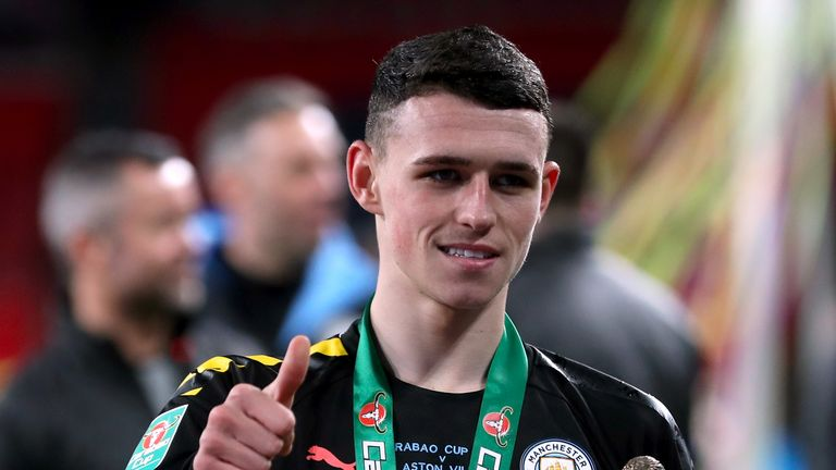Manchester City's Phil Foden with his man of the match trophy after his side beat Aston Villa to win the Carabao Cup Final