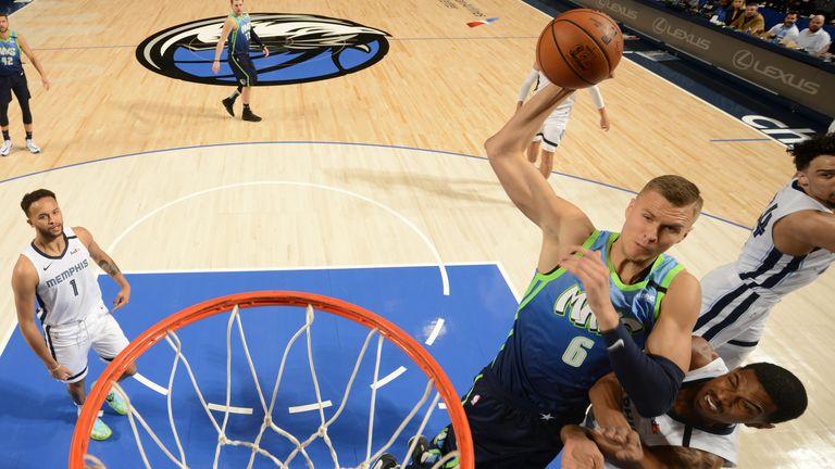 Kristaps Porzingis of the Dallas Mavericks drives to the basket against the Memphis Grizzlies