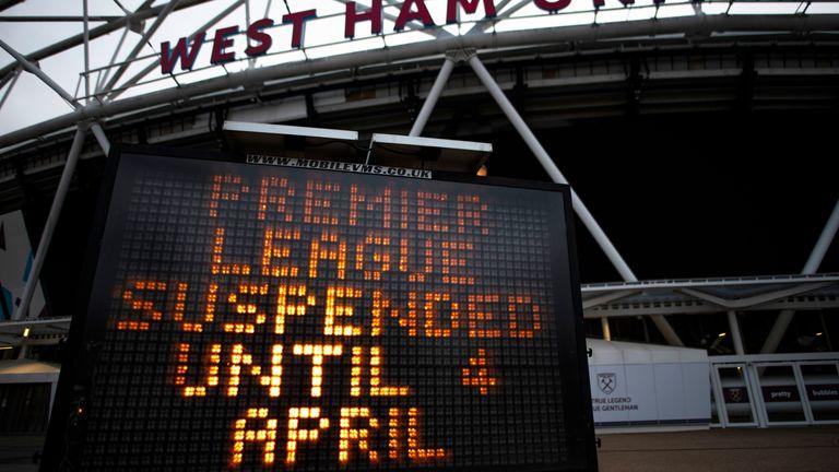 A message outside the London Stadium reads 'Premier League Suspended Until 4 April'