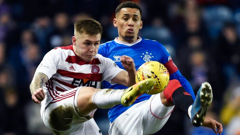 Hamilton's Scott Martin (L) is pictured in action with Rangers' James Tavernier