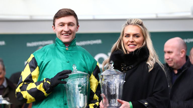 Jockey Adam Wedge and trainer Rebecca Curtis with their Stayers' Hurdle trophies