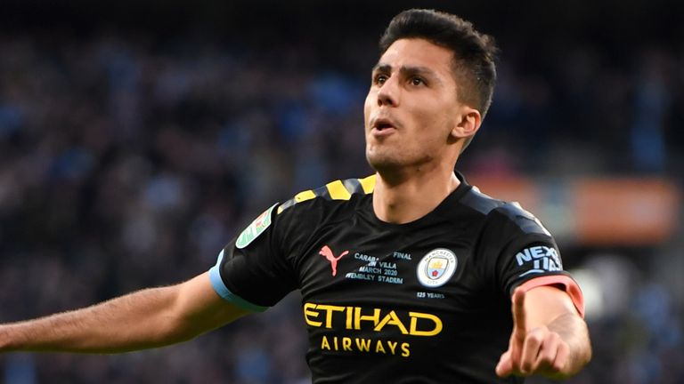 Rodri celebrates Manchester City's second in the Carabao Cup Final.