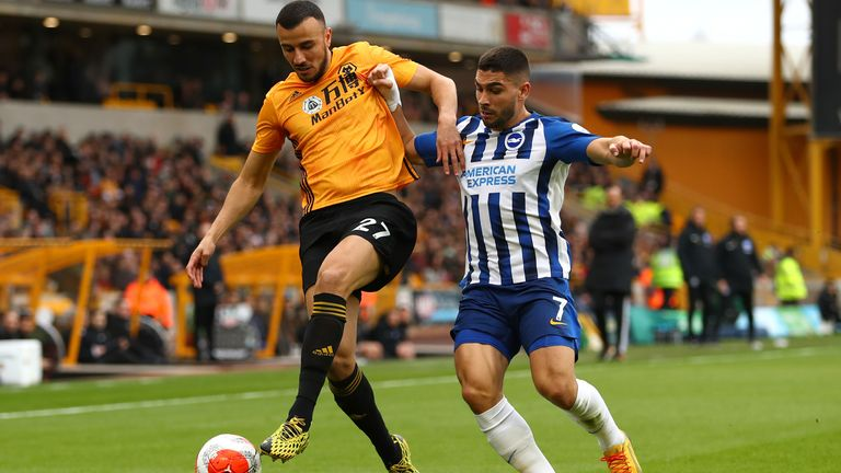 Romain Saiss and Neal Maupay vie for the ball during Wolves and Brighton's Premier League game at Molineux