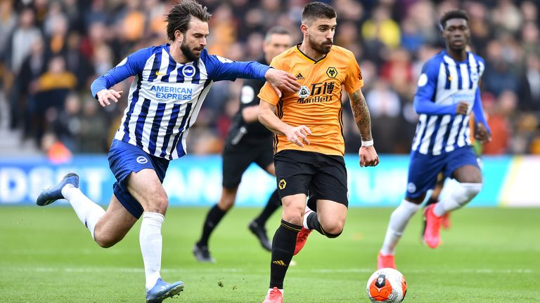 Ruben Neves holds off his marker as Wolves take on Brighton