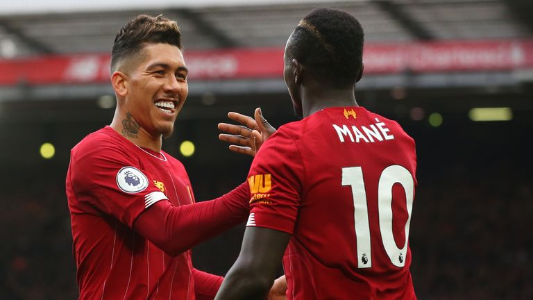 Sadio Mane and Roberto Firmino celebrate Liverpool's triumph over Bournemouth as the Reds close in on the title