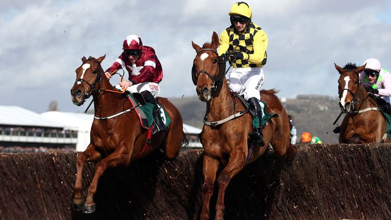 Samcro ridden by Davy Russel (left) and Melon ridden by Mr P W Mullins during the Marsh Novices Chase during day three of the Cheltenham Festival at Cheltenham Racecourse. PA Photo. Picture date: Thursday March 12, 2020. See PA story RACING Cheltenham. Photo credit should read: Tim Goode/PA Wire. RESTRICTIONS: Editorial Use only, commercial use is subject to prior permission from The Jockey Club/Cheltenham Racecourse.