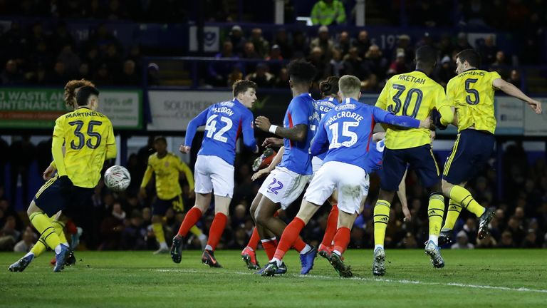 PORTSMOUTH, ENGLAND - MARCH 02: Sokratis Papastathopoulos of Arsenal (R) scores his team's first goal during the FA Cup Fifth Round match between Portsmouth FC and Arsenal FC at Fratton Park on March 02, 2020 in Portsmouth, England. (Photo by Richard Heathcote/Getty Images