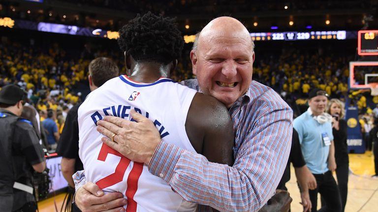 LA Clipper owner Steve Ballmer hugs Patrick Beverley