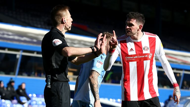 Kyle Lafferty argues with the referee after Luke O'Nien's goal was ruled out for offside