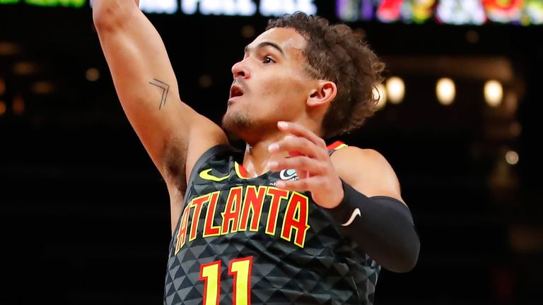 Trae Young lofts a floater against the Charlotte Hornets