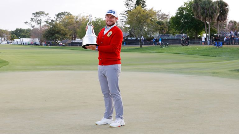 Hatton received a red alpaca cardigan, along with the trophy, in honour of Arnold Palmer, who often wore a similar sweater