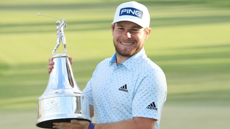 Tyrrell Hatton with the Arnold Palmer Invitational trophy just before the golfing shutdown