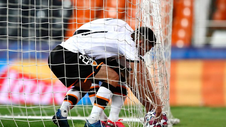 Valencia desperately get the ball out of the net after Kevin Gameiro's goal
