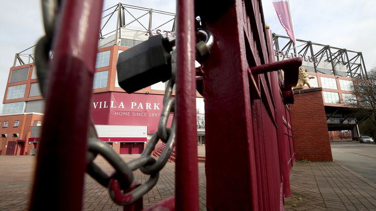 A view of locked gates at Villa Park in Birmingham. All Premier League football has been suspended in response to the Coronavirus pandemic