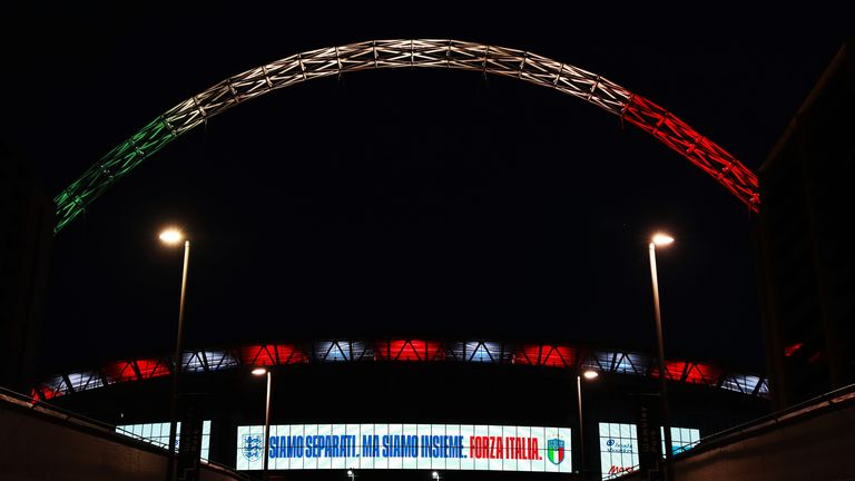 The Wembley arch is lit up in the colours of the Italian flag in a show of solidarity amid the coronavirus pandemic