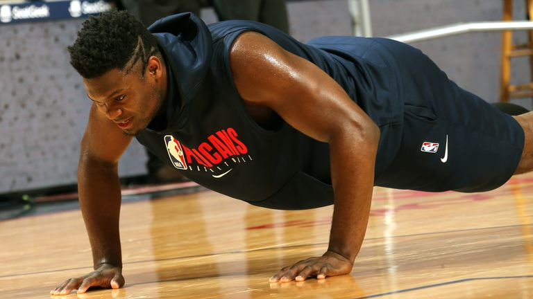 Zion Williamson does press-ups on court prior to a Pelicans game