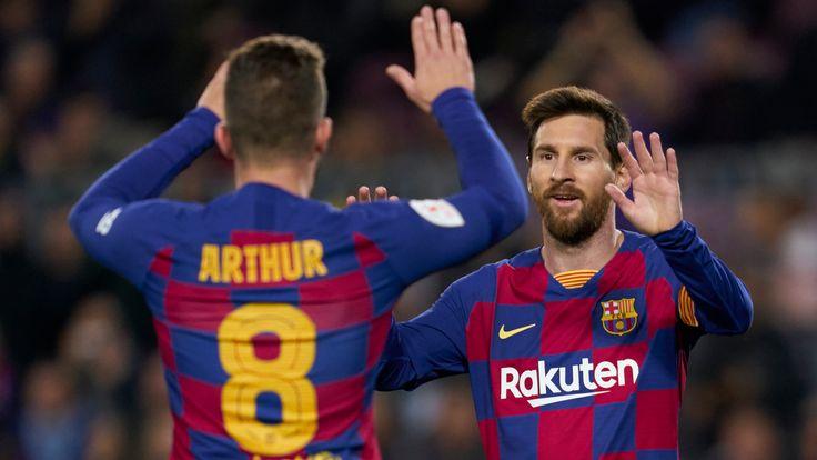 Arthur Melo celebrates with Barcelona team-mate Lionel Messi