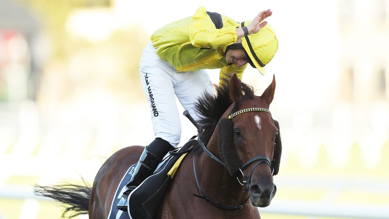 Tom Marquand riding Addeybb celebrates winning the Longines Queen Elizabeth Stakes
