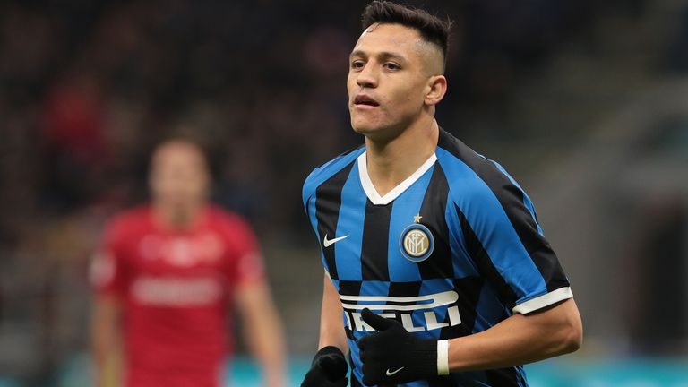 Alexis Sanchez in action during the Coppa Italia quarter-final match between Inter and Fiorentina