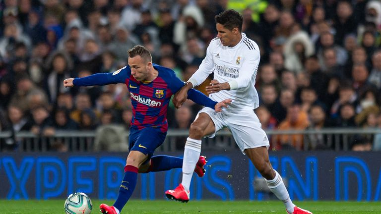 Arthur shields the ball for Barcelona during El Clasico against Real Madrid