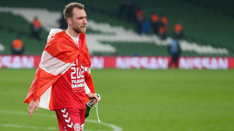 Christian Eriksen of Denmark celebrates qualification with a bottle of Carlsberg during the UEFA Euro 2020 qualifier between Republic of Ireland and Denmark so at Dublin Arena on November 18, 2019 in Dublin