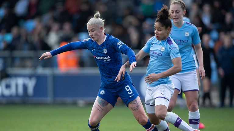 Bethany England of Chelsea and Demi Stokes of Manchester City in action during the FA Women's Super League
