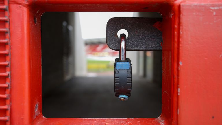 A view of locked gates at a football stadium